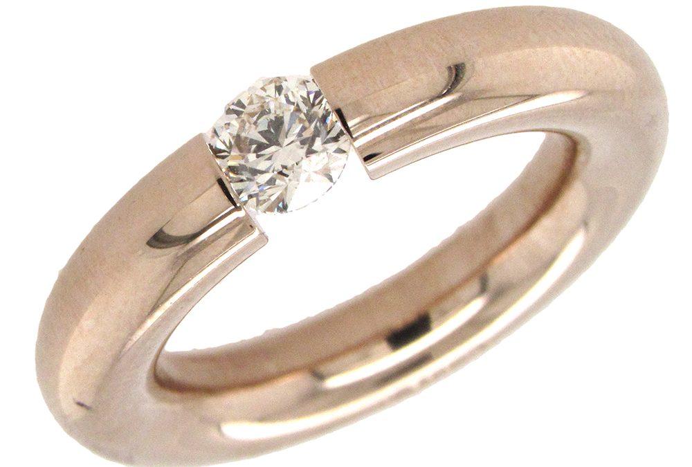 Niessing:  18K Gold Diamond Tension-Set Ring
